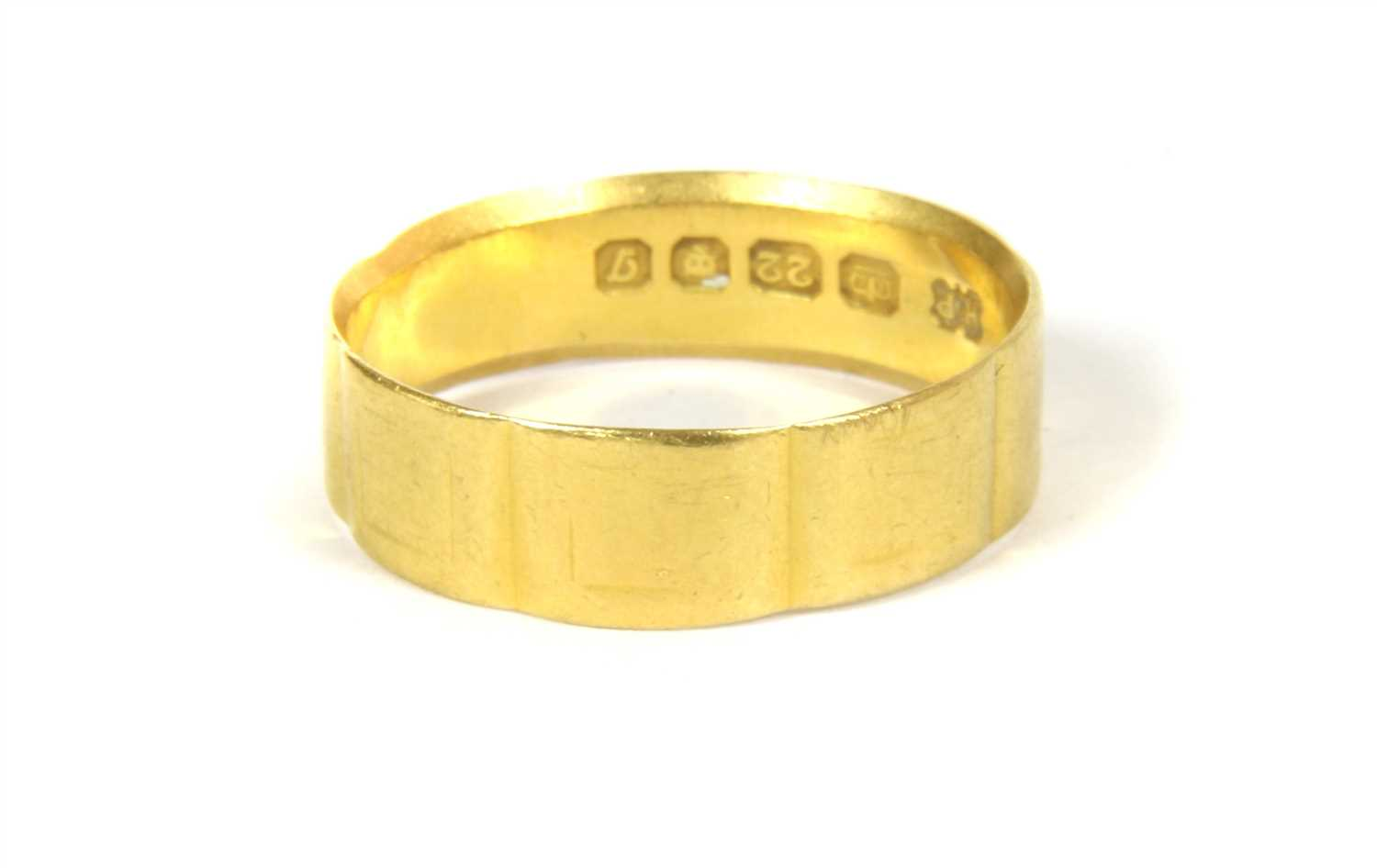 Lot 16-A 22ct gold flat profile wedding ring