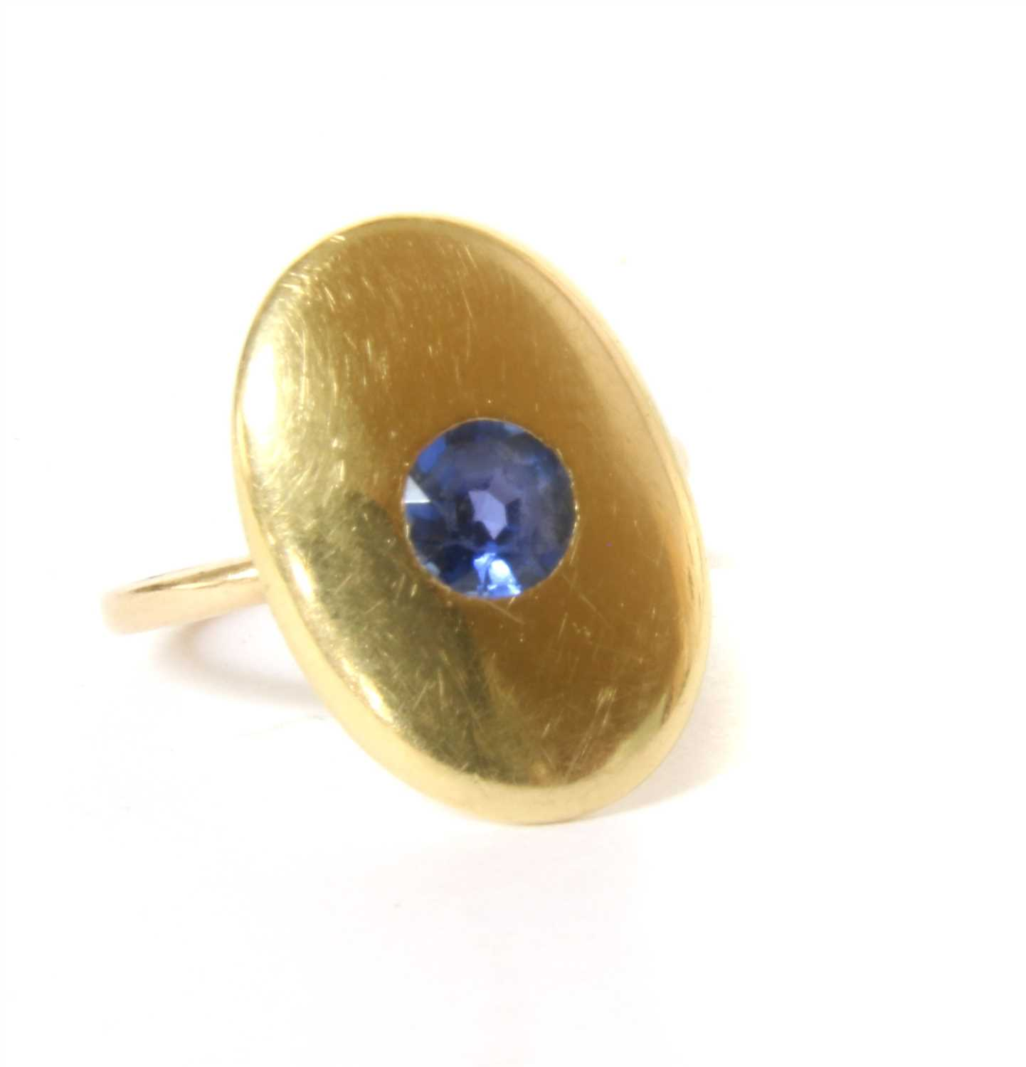 Lot 1-An oval cufflink later converted to a ring