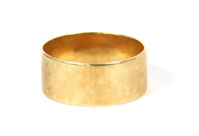 Lot 9-An 18ct gold flat profile wedding ring