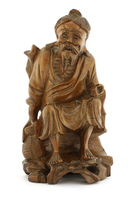 Lot 336 - A Chinese wood carving