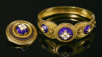 Lot 28-A cased Victorian gold split pearl, diamond and enamel bangle, c.1860