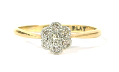 Lot 40-A gold diamond daisy cluster ring