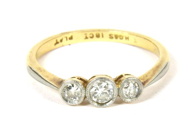 Lot 31-A gold three stone diamond ring