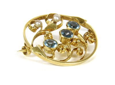 Lot 23-An Edwardian gold aquamarine and seed pearl brooch