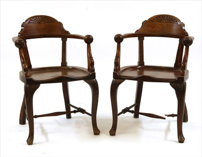 Lot 88 - A pair of unusual oak smokers' bow elbow chairs