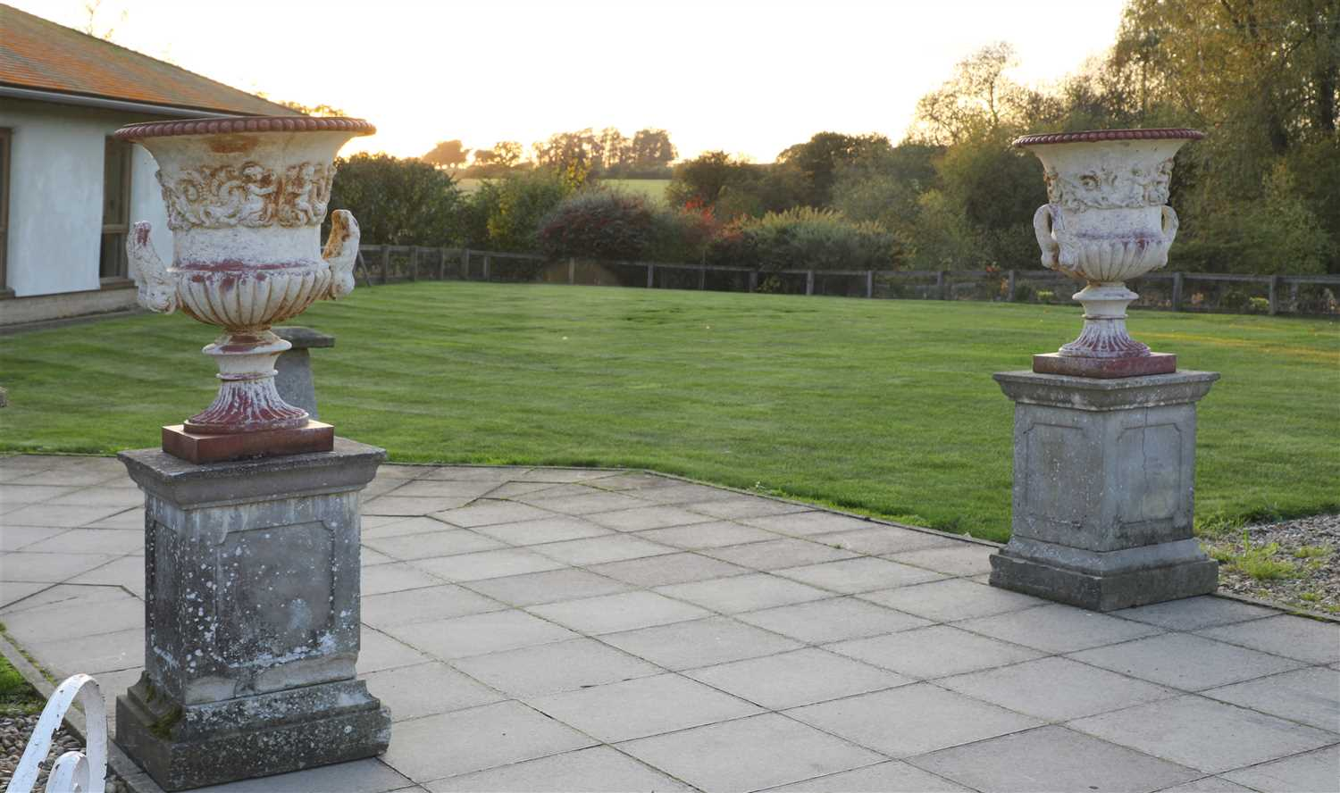Lot 940-A pair of cast iron urns