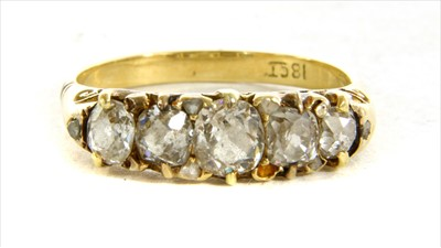 Lot 6-A Victorian five stone diamond carved head ring