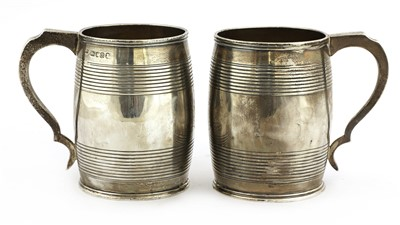 Lot 4-A pair of George III silver mugs