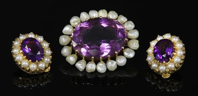 Lot 45-A late Victorian gold amethyst and pearl oval brooch