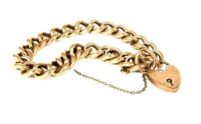 Lot 16-A hollow curb link bracelet with heart padlock clasp