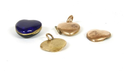 Lot 10-A hinged black and blue enamel heart shaped locket