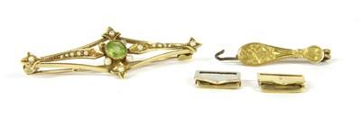 Lot 1-An Edwardian peridot and seed pearl bar brooch