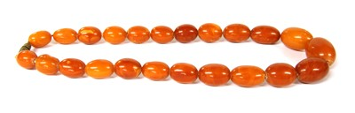 Lot 13-A single row graduated oval butterscotch amber bead necklace