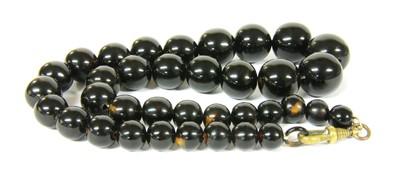 Lot 12-A single row graduated round tortoiseshell bead necklace