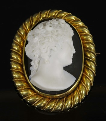 Lot 32-A cased Victorian gold carved hardstone cameo brooch
