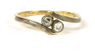 Lot 21-A diamond two stone crossover ring