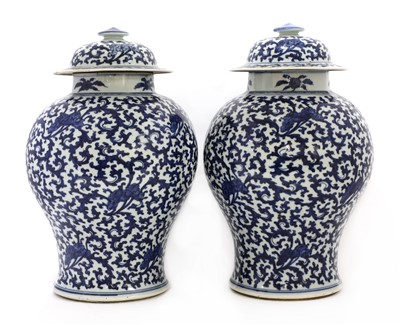 Lot 17-A pair of Chinese blue and white vases and covers