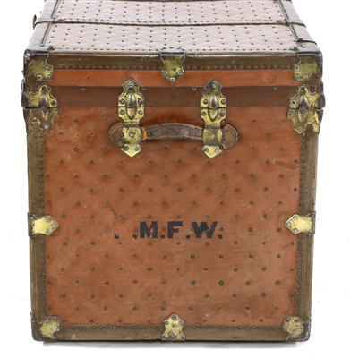 Lot 903 - A large leather and studded travelling trunk