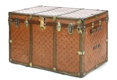 Lot 903-A large leather and studded travelling trunk