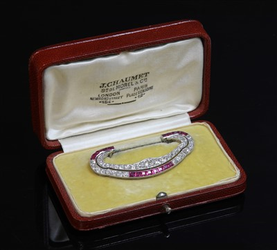 Lot 199 - A cased Art Deco platinum and gold, ruby and diamond brooch attributed to Chaumet c.1930