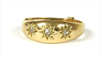 Lot 2-An 18ct gold three stone diamond ring