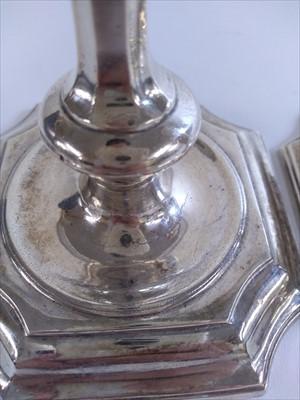 Lot 9-A pair of George I Britannia standard silver candlesticks