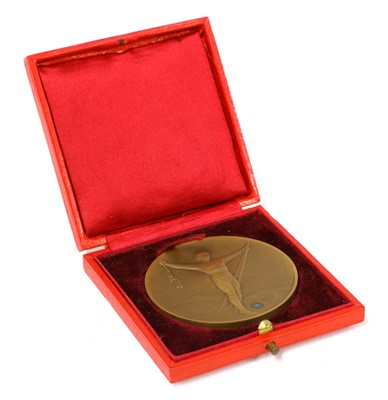 Lot 172-A bronze medal from the 1924 Winter Olympics at Chamonix, designed by Raoul Bernard