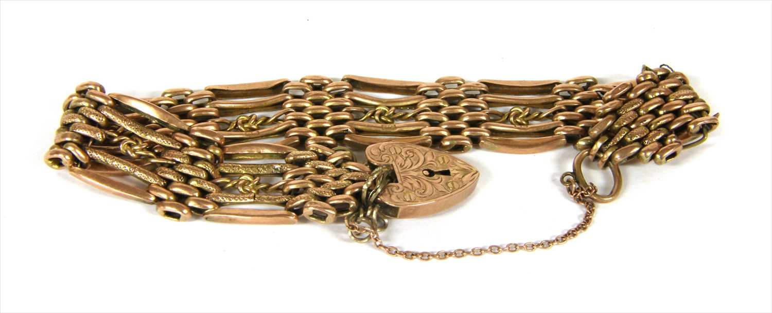 Lot 8-A gold five row gate bracelet