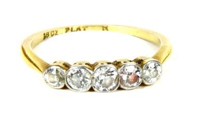 Lot 14-A five stone diamond ring