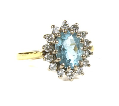 Lot 3-An 18ct gold aquamarine and diamond oval cluster ring