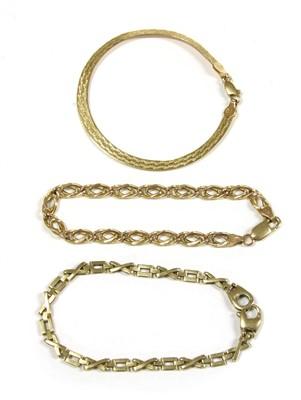 Lot 1015-A 9ct gold engraved herringbone link bracelet
