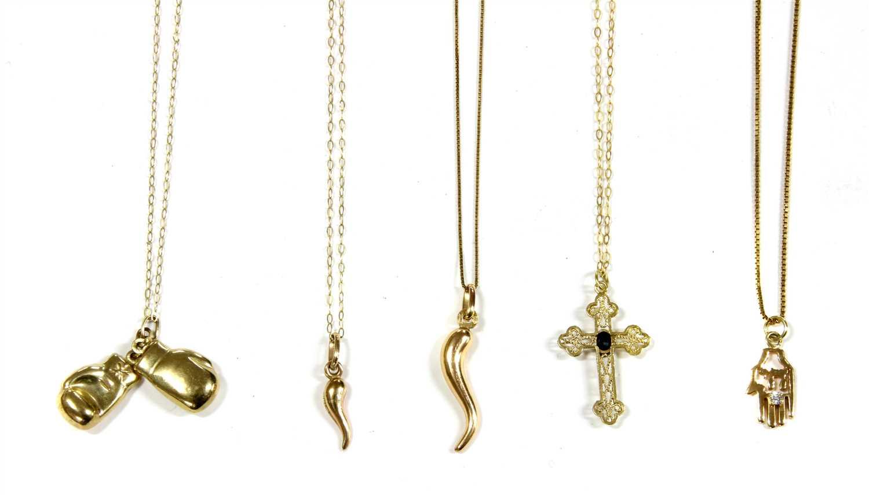 Lot 1009-Two Italian 9ct gold hollow cornicello pendants