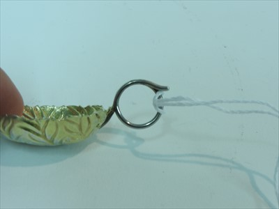 Lot 13-A silver gilt caddy spoon