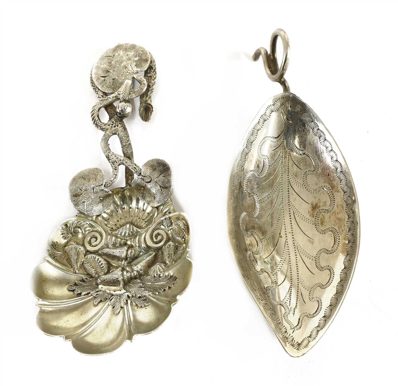 Lot 20-A George III silver leaf-shaped caddy spoon
