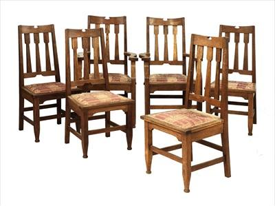 Lot 44-A set of six Arts & Crafts oak chairs