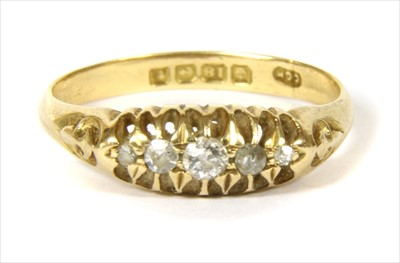 Lot 4-An 18ct gold diamond boat shaped ring