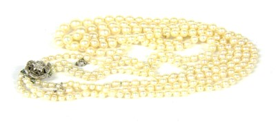 Lot 1023-A three row graduated cultured pearl necklace