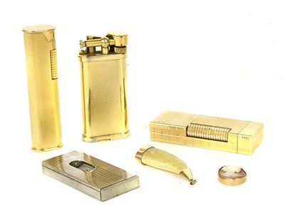 Lot 1025-Three gold plated Dunhill lighters
