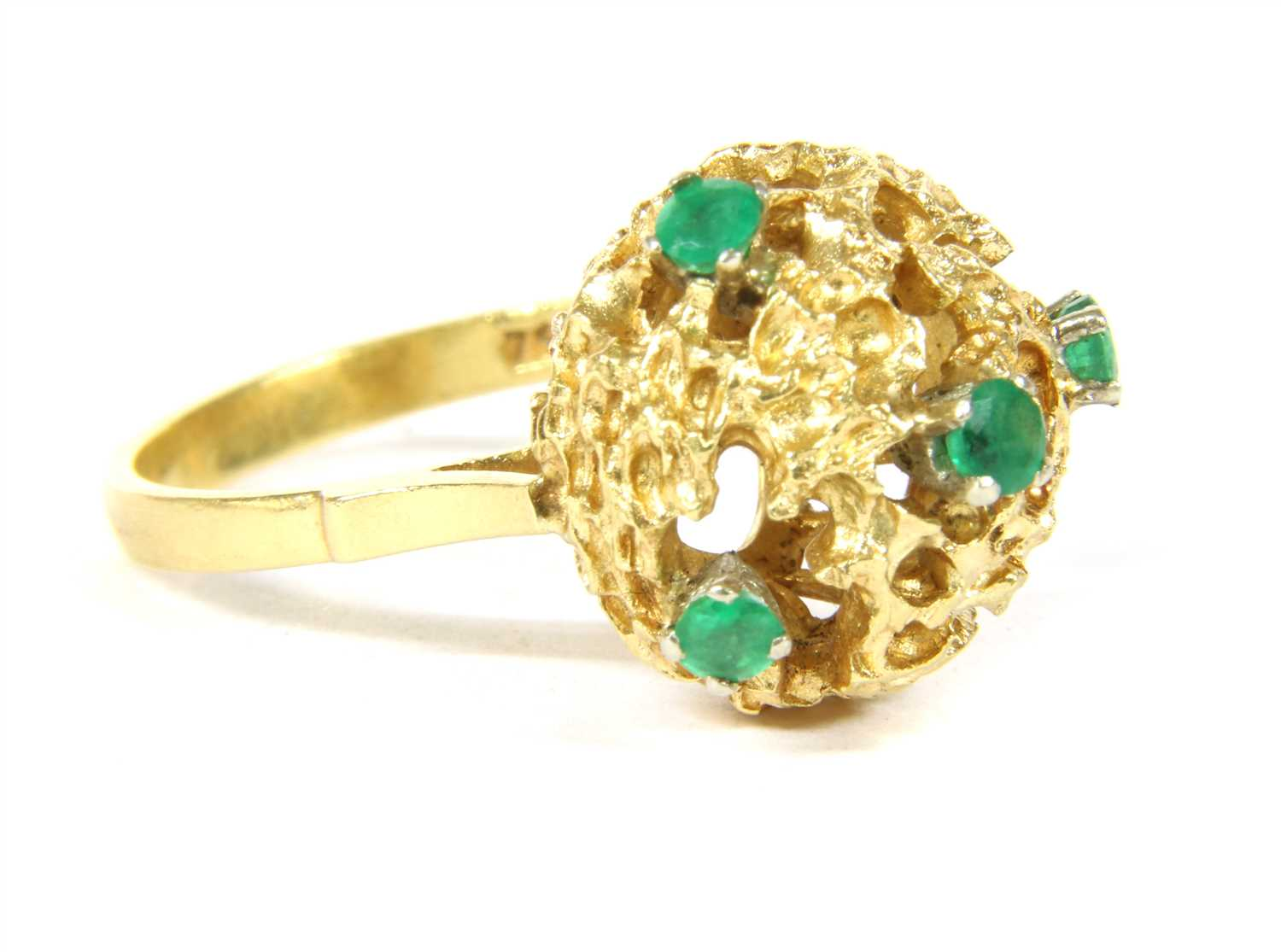 Lot 1018-An Italian 18ct gold emerald ring