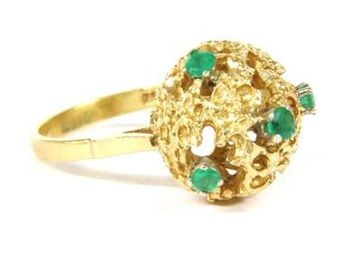 Lot 1018-An Italian 18ct gold emerald ring