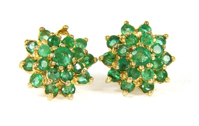 Lot 1017-A pair of 9ct gold emerald cluster earrings
