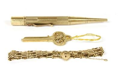 Lot 1021-A 9ct gold door key