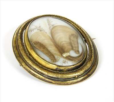 Lot 15-A Victorian gold mourning brooch