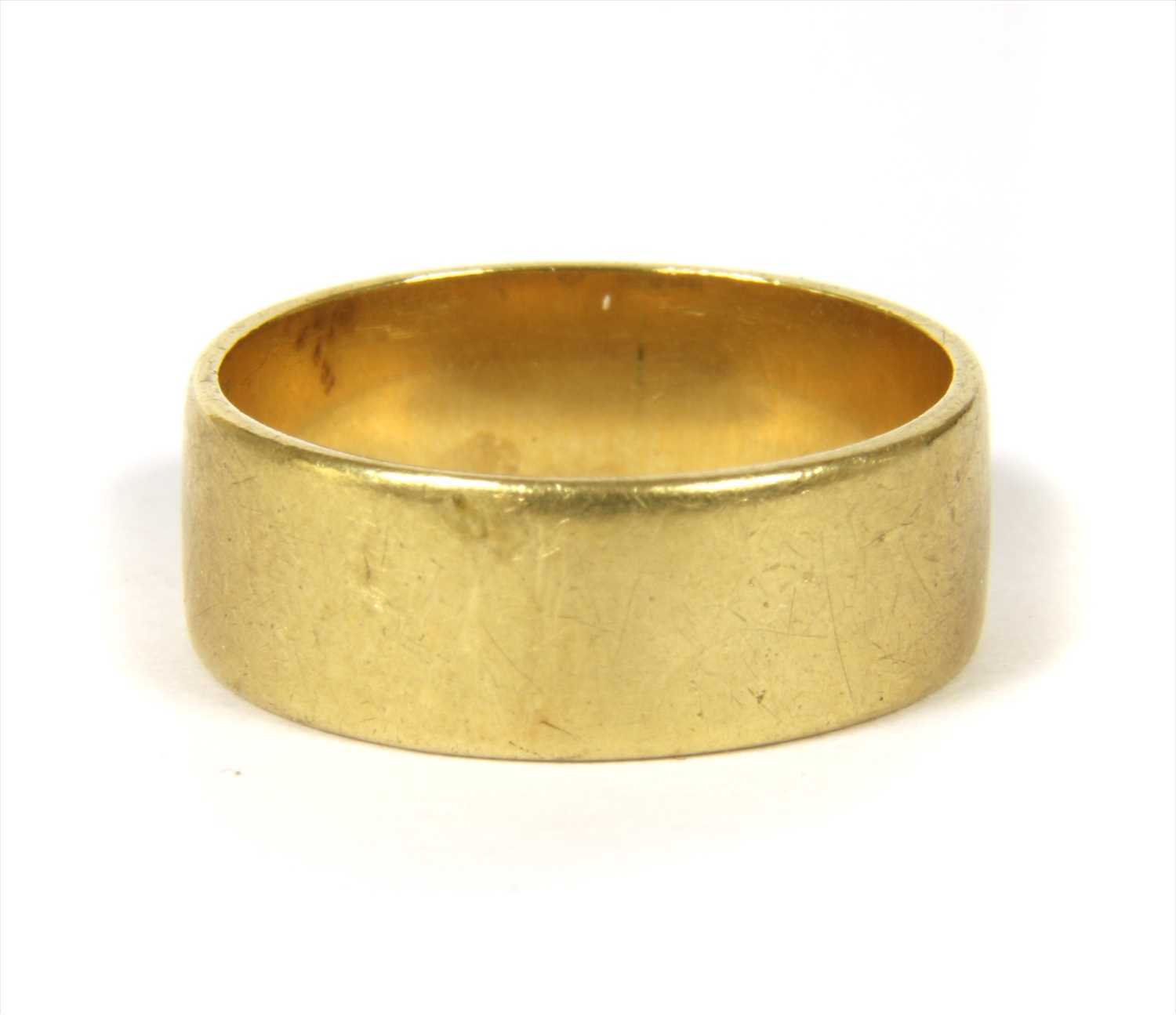 Lot 23-An 18ct gold flat section wedding ring