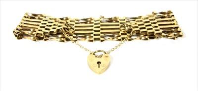 Lot 9-A 9ct gold seven row gate bracelet