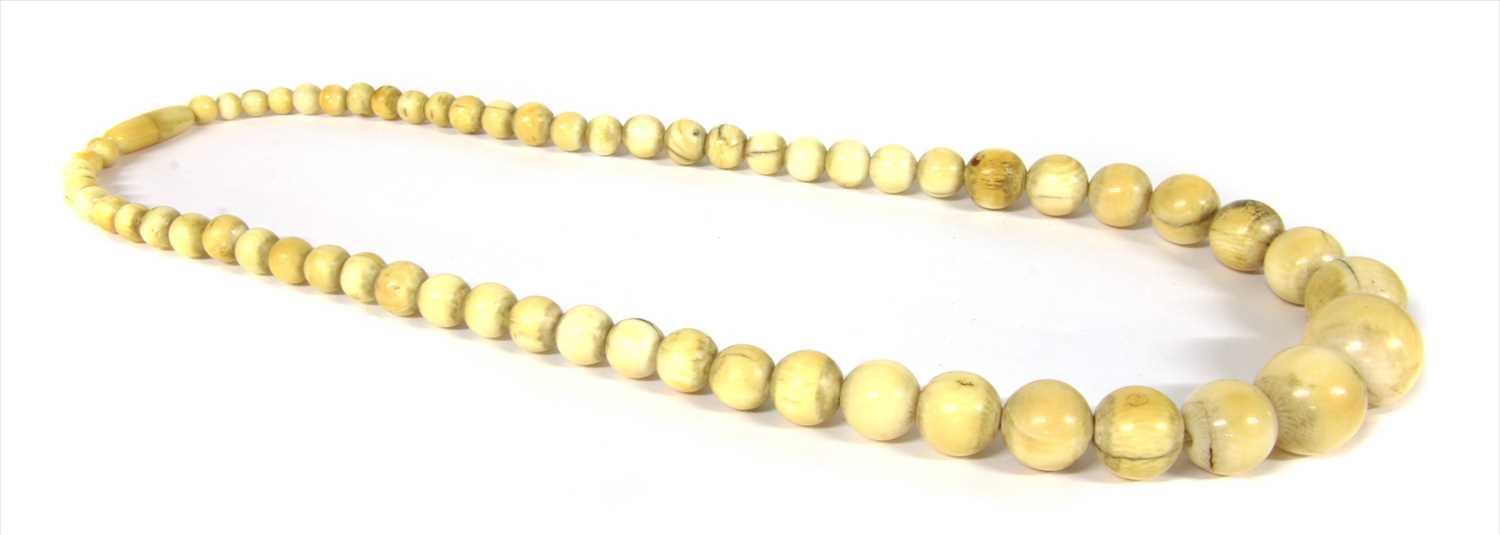 Lot 17-A single row graduated ivory bead necklace, c.1900
