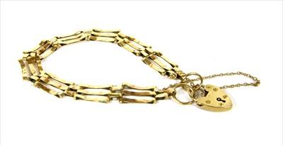 Lot 10-A 9ct gold three row gate bracelet