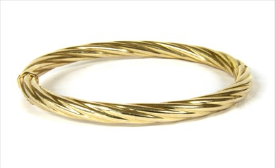Lot 12-An Italian 9ct gold hinged twisted wire bangle