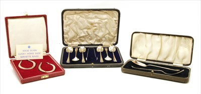 Lot 33-A cased set of novelty silver napkin rings