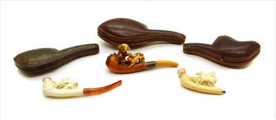 Lot 42-Three figural meershaum pipes